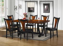 black wooden dining table with black leather seat cover and brown