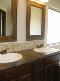 bathroom cabinets framing a bathroom mirror that has clips