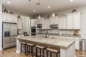 traditional kitchen with kitchen island u0026 hardwood floors in