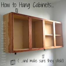 how to hang a cabinet to the wall how to hang cabinets s big idea hanging kitchen