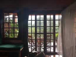 french doors leading to balcony canopy bed in frame picture of