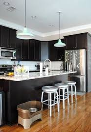 espresso cabinets and blue grey wall paint try java gel stain