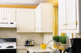 how to clean factory painted kitchen cabinets pro secrets for painting kitchen cabinets kitchen cabinets