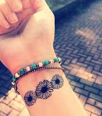 23 daisy flowers wrist tattoos