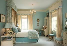 small chandelier in blue and white bedroom