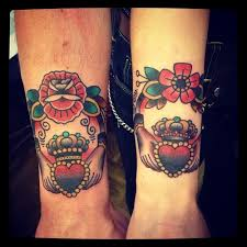 heart with a crown traditional tattoo on hands traditional tattoos