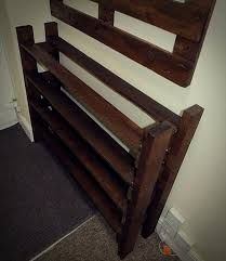 a hallway pallet coat rack and shoe rack that is both good looking