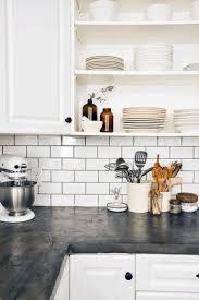 Black Cabinet Kitchen Black Wood Countertop White Brick Pattern Of Backsplash Tile