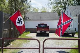 Michigans Flag And Confederate Flags Flying At North Flint Home Confuse