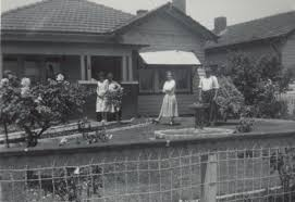 digital photograph family standing outside californian bungalow