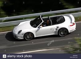 white porsche 911 turbo porsche 911 turbo convertible model year 2007 white driving