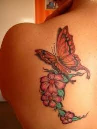 beautiful flowers and monarch butterfly back shoulder tattoos