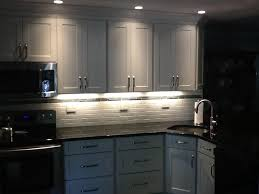 beautifully kitchen design features angle cut crown molding