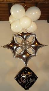 gold and black double bubble with star foil balloon centerpiece