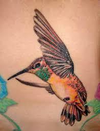 small hummingbird tattoo design on chest tattoomagz