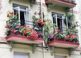 two old balconies with flowers in santander spain stock photo
