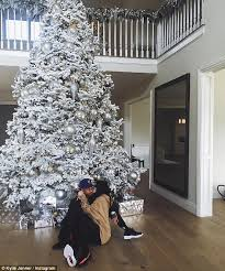 kylie jenner snuggles under christmas tree with tyga daily mail