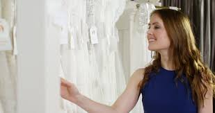 of the gowns 4k woman shopping for wedding dress reaching out to touch the