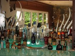 custom bar in a luxury yacht glass counter tops led liquor