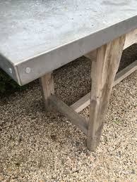 long zinc console with weathered base mecox gardens