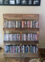 Dvd Shelf Wood Plans by Pallet Wood Dvd Rack Pallet Crafts Pinterest Dvd Rack