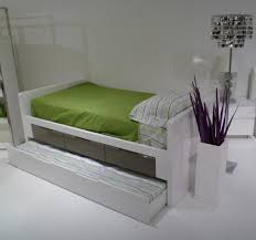 bedroom twin bed with trundle and white flooring also floor lamp