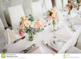 beautiful flowers as dining table decoration stock photo image