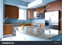 Light Blue Walls by New Modern Kitchen Interior Island Condo Stock Photo 33401740