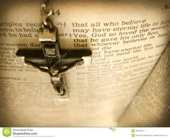 handmade rosary crucific hangs over bible verse from heaven u0027s view