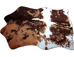 pouf en peau de vache tapis imitation vache synthétique marron et blanc peaudevache com