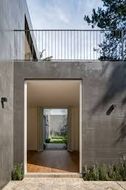 interior concrete walls modern concrete home in mexico city unfurls around two courtyards