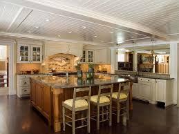 white kitchen cabinets with backsplash white kitchen cabinets purple pendant lights panel fridge range
