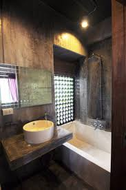 bathroom dark bathroom design with painted concrete wall and