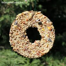 and adults can both make these easy birdseed ornaments garden