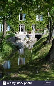 french country house with a stream running through it to a water