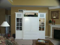 entertainment centers with glass doors high white wooden cabinet with television storage on the middle