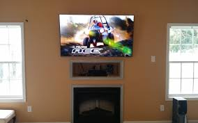 tv above fireplace cable box ideas stovers