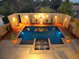 modern landscape lighting ideas around small pool with deck for