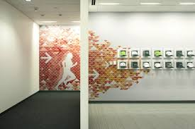 Boldly Colored And Patterned Wall Graphics Energize The Company - Wall graphic designs