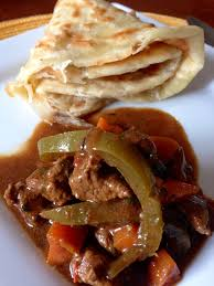 mchuzi wa nyama curried beef stew with peppers and vegetables