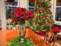 the table u0027s elegant floral centerpiece is made of red roses red