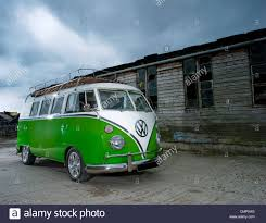 volkswagen green green camper van side view isolated on white stock photo royalty