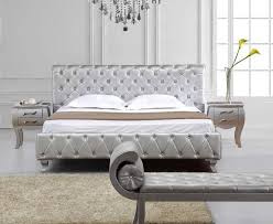 silver bed tufted silver leather all around the bed crystals on headboard