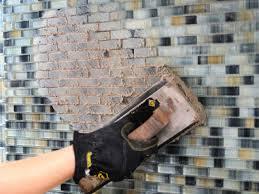 kitchen subway tile back splash in a herringbone pattern simply