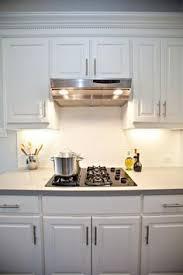 The Kitchen Includes A Subway Tile Backsplash Birch Cabinets - Subway tiles kitchen backsplash
