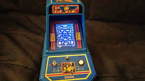 the real ms pac man playing on coleco mini arcade table top