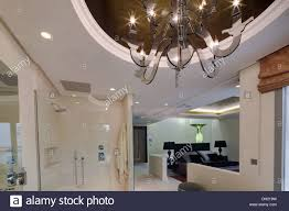 modern glass chandelier on recessed ceiling in shower area of