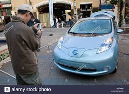 new nissan leaf man photographing new nissan leaf nissan leaf zero emission tour