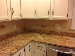 pictures of kitchen backsplashes with granite countertops kitchen backsplash granite countertop wood cabinet with doors
