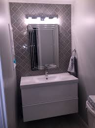 floating bathroom vanity with dove grey arabesque tile wall